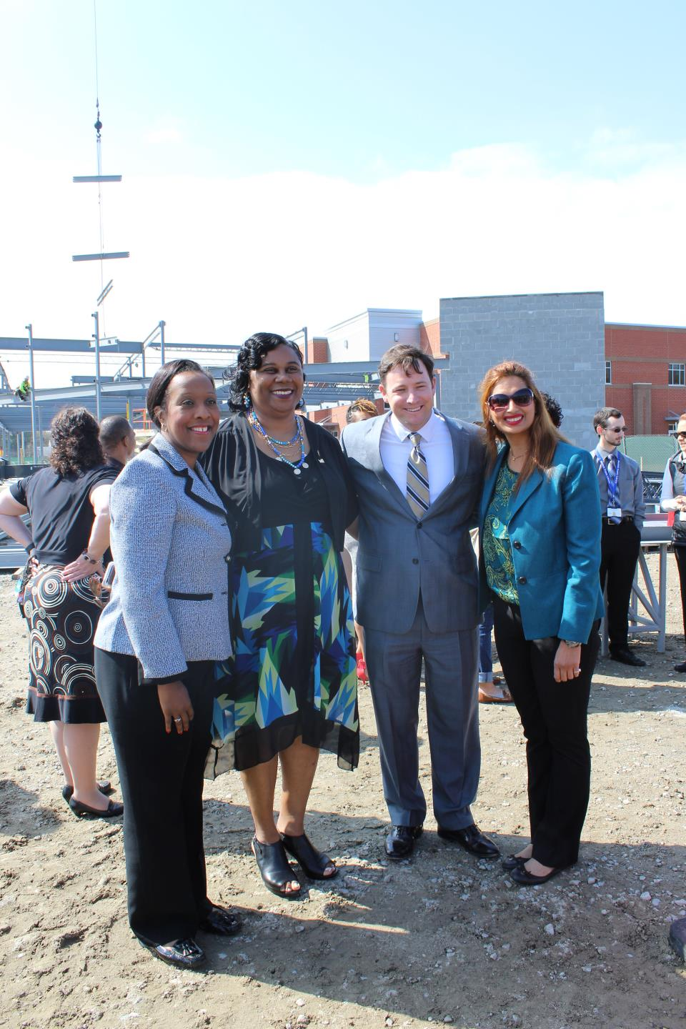 City Council Members Angelia Graves and Mamie Johnson with the Chairman of the NPL Board of Trustees, Roy B. Martin IV, and Director of Libraries, Sonal Rastogi.