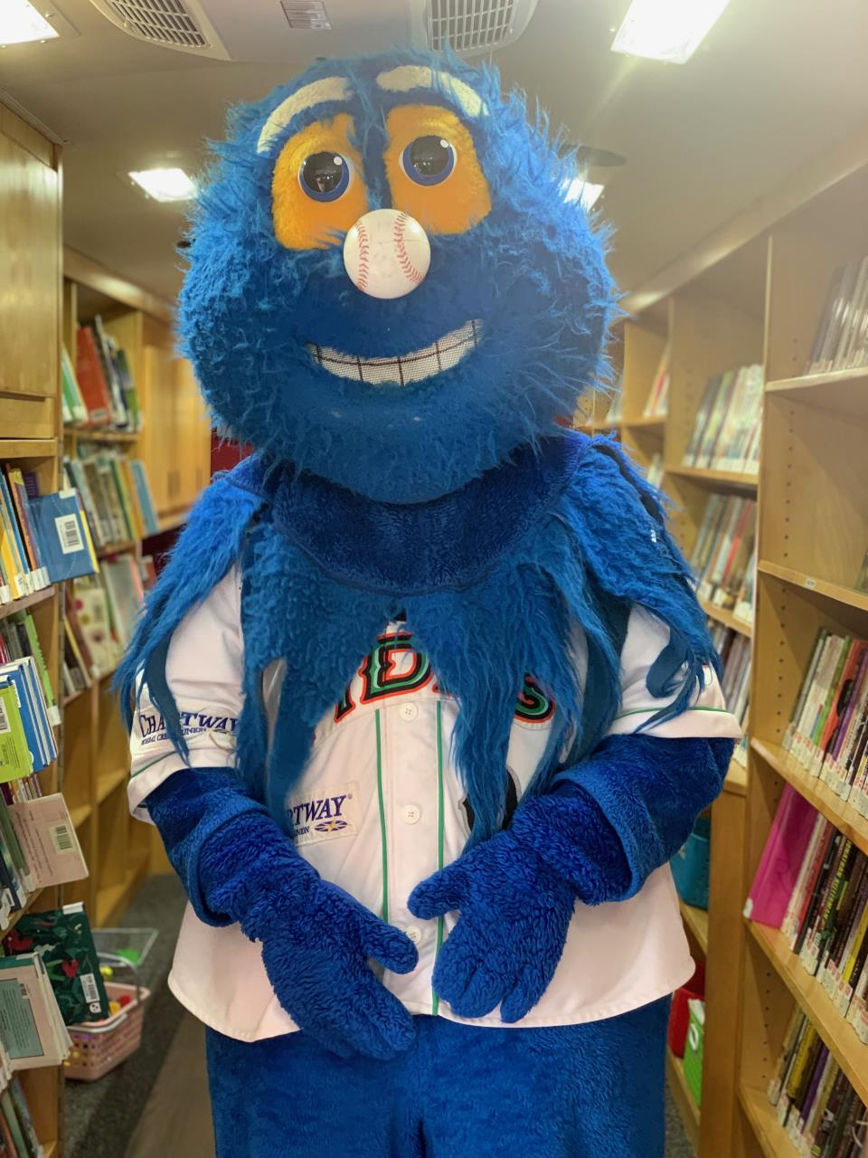 Norfolk Tides' Riptide mascot inside the Bookmobile.