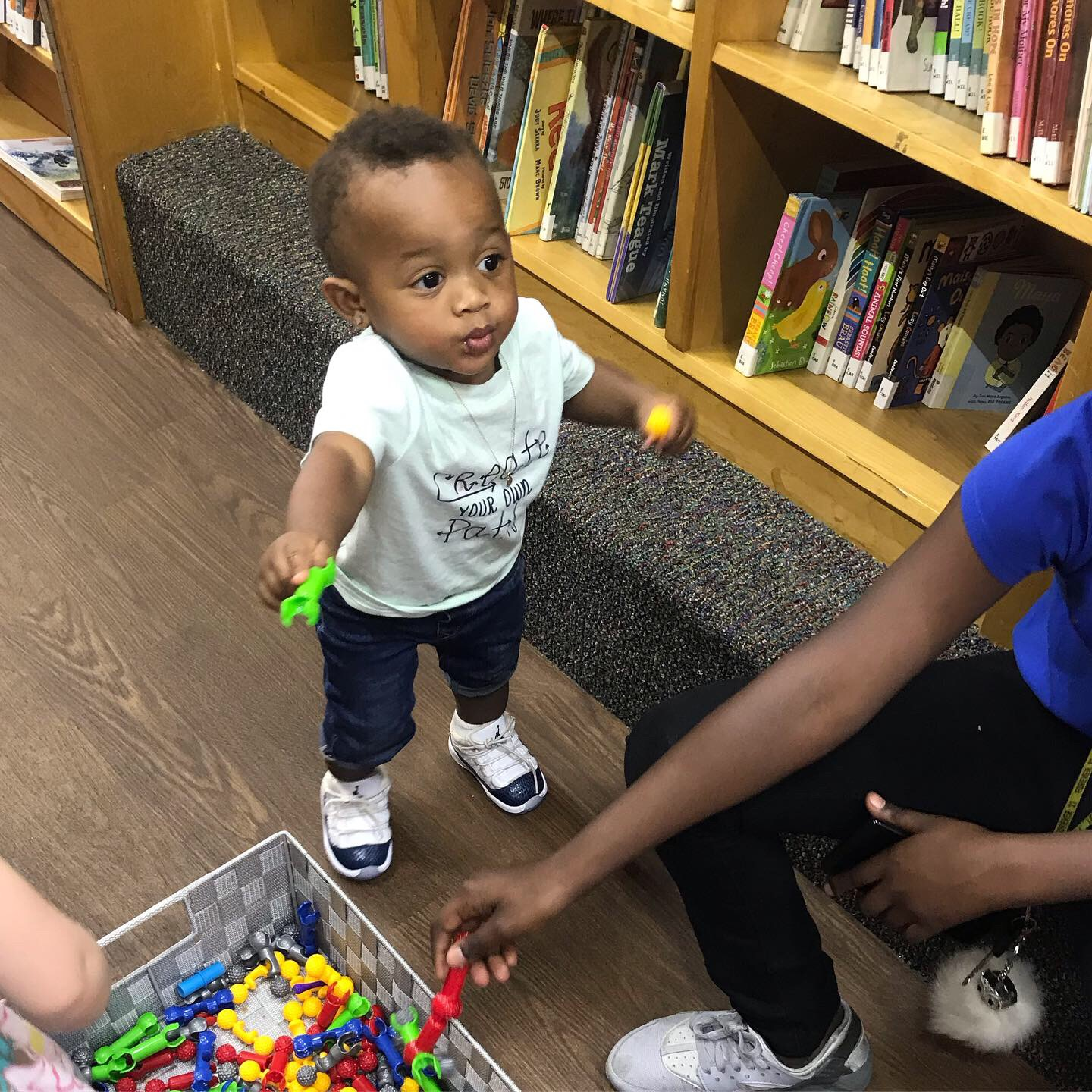 Toddler plays on the Bookmobile